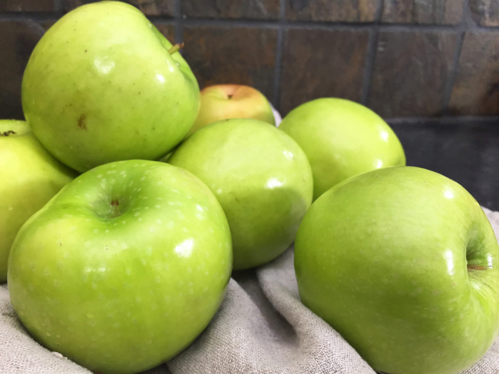 Pile of apples on the counter