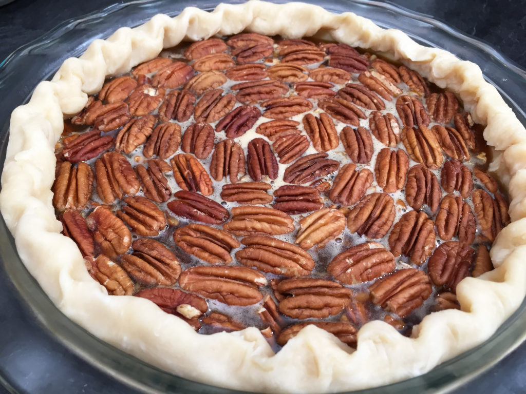 pecan pie with crimped edge ready for oven