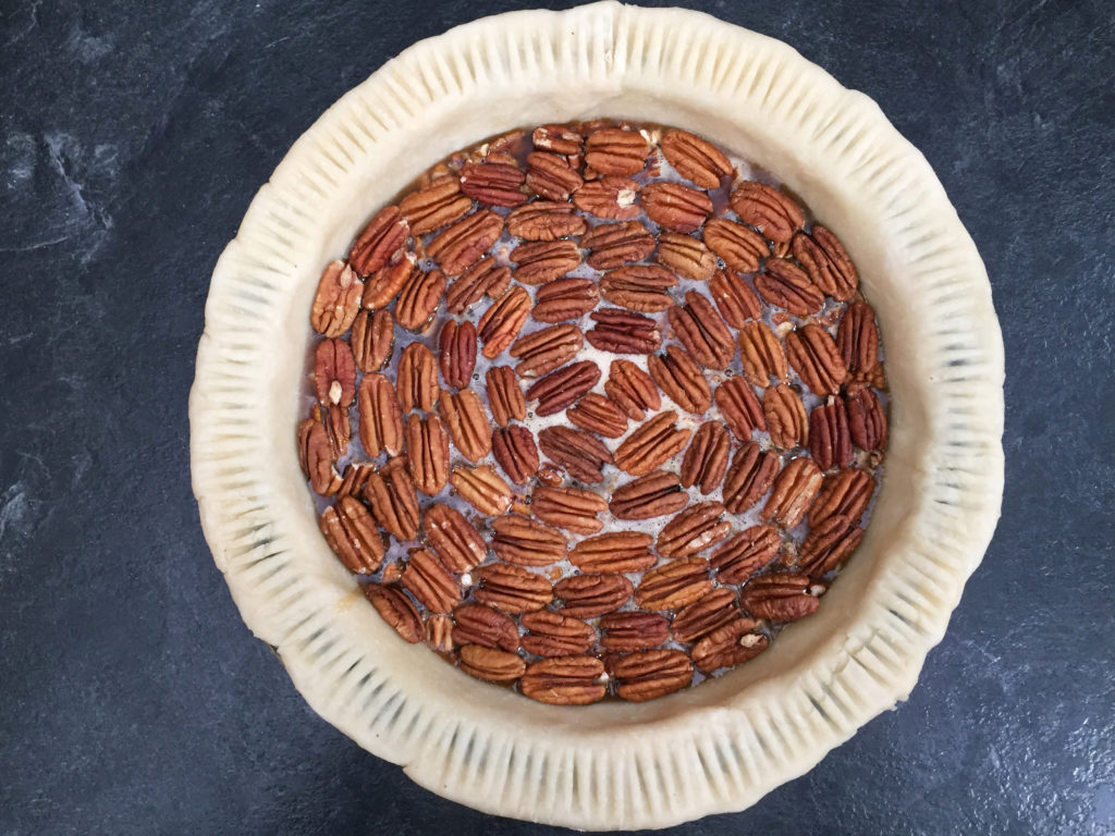 pecan pie with fork patterned crust edge
