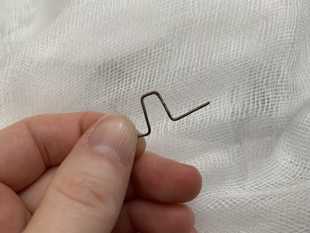 bending hair pin to use as a hook