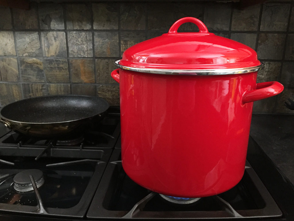 big red pot on stove
