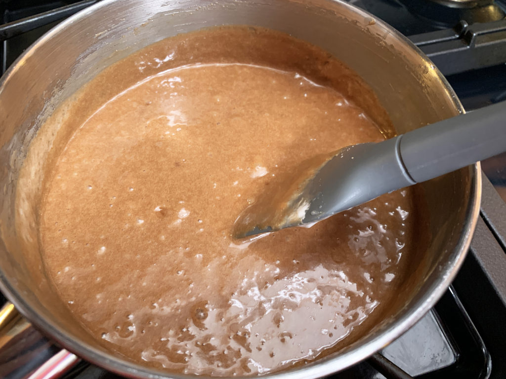 frosting cooked and ready for pouring