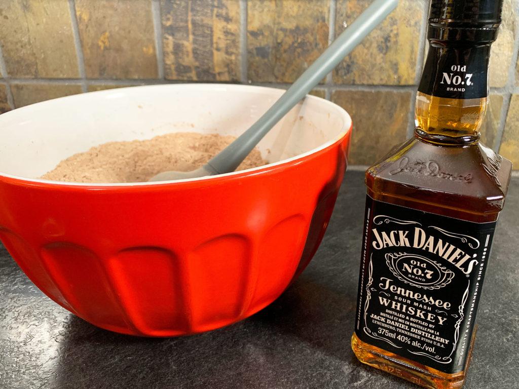 dry ingredients beside a bottle of jack daniels