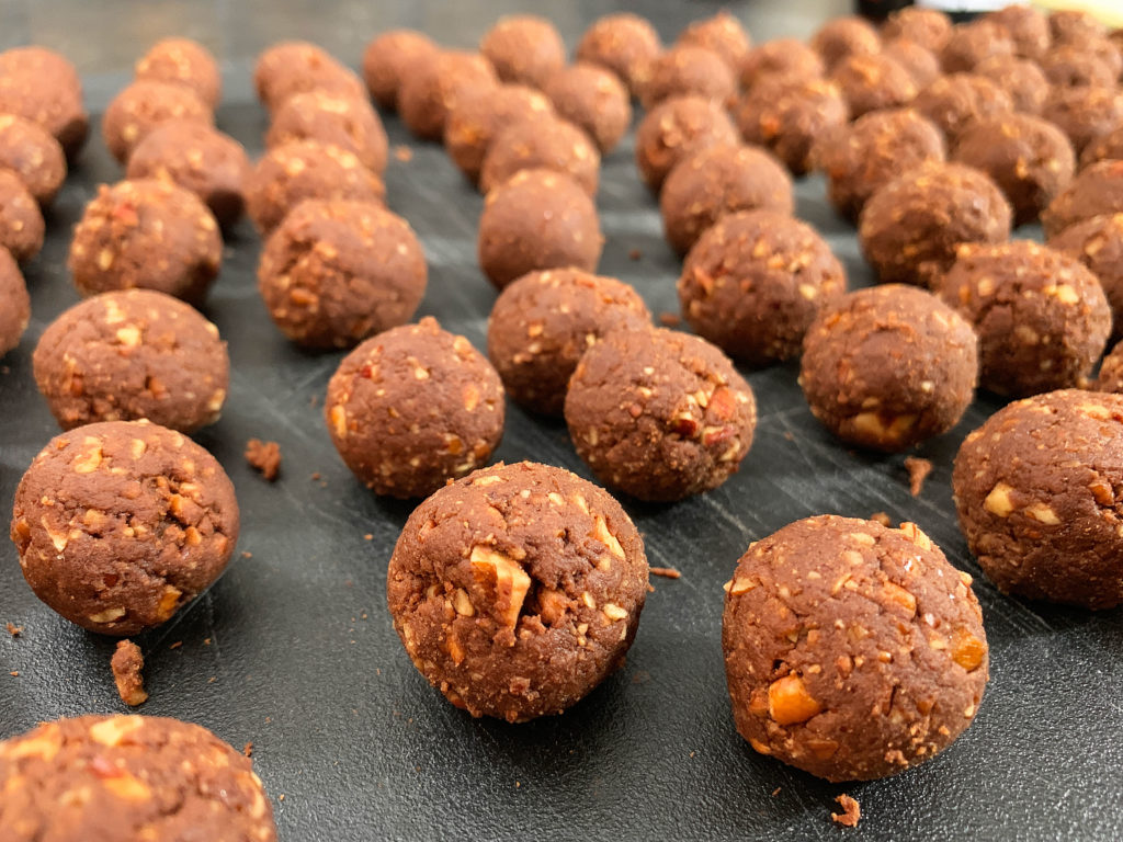 bourbon ball mixture rolled into one inch balls