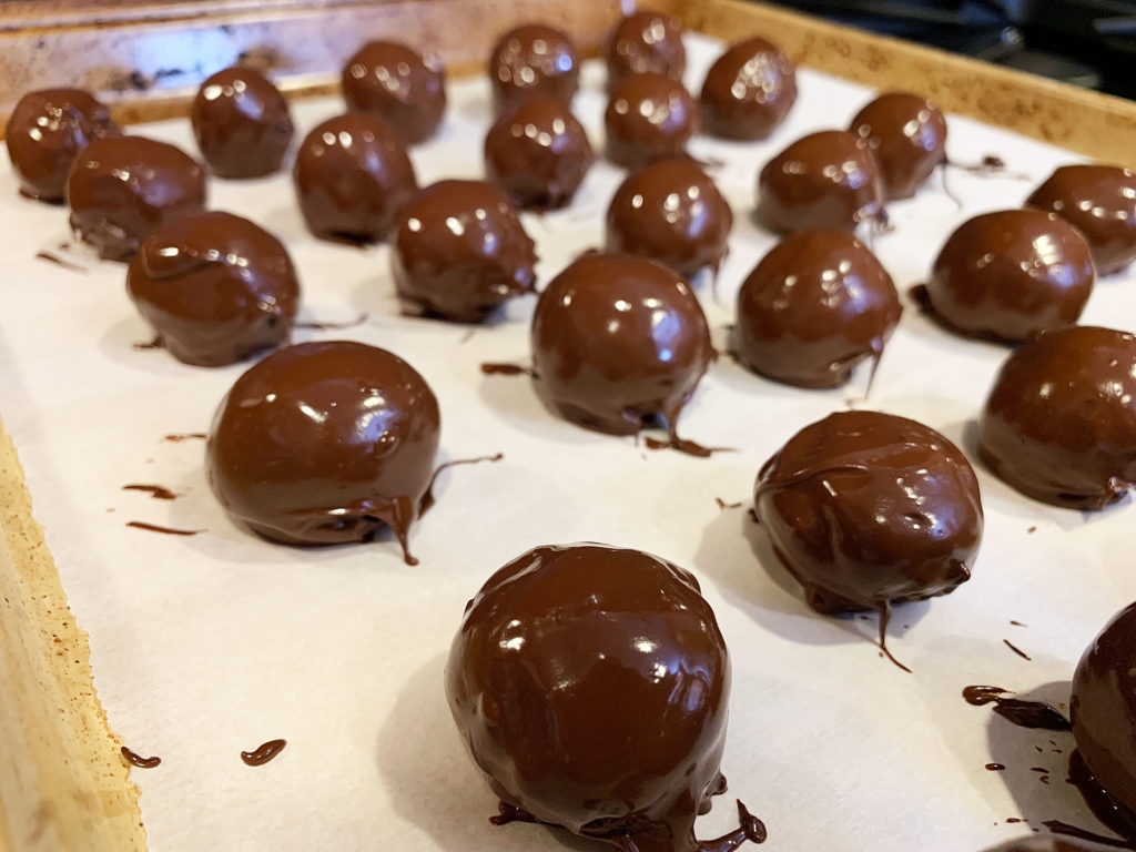 tray of chocolate dipped bourbon balls