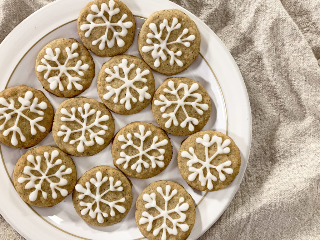 plate of iced chai snowflake cookies