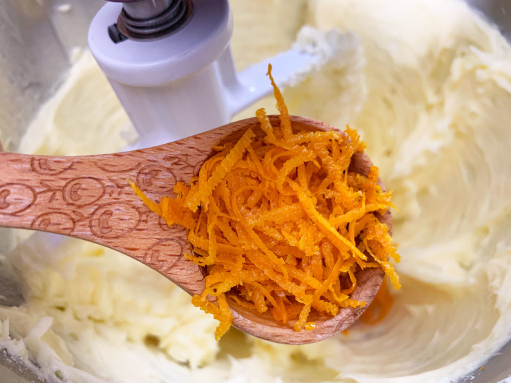 adding orange zest to the butter