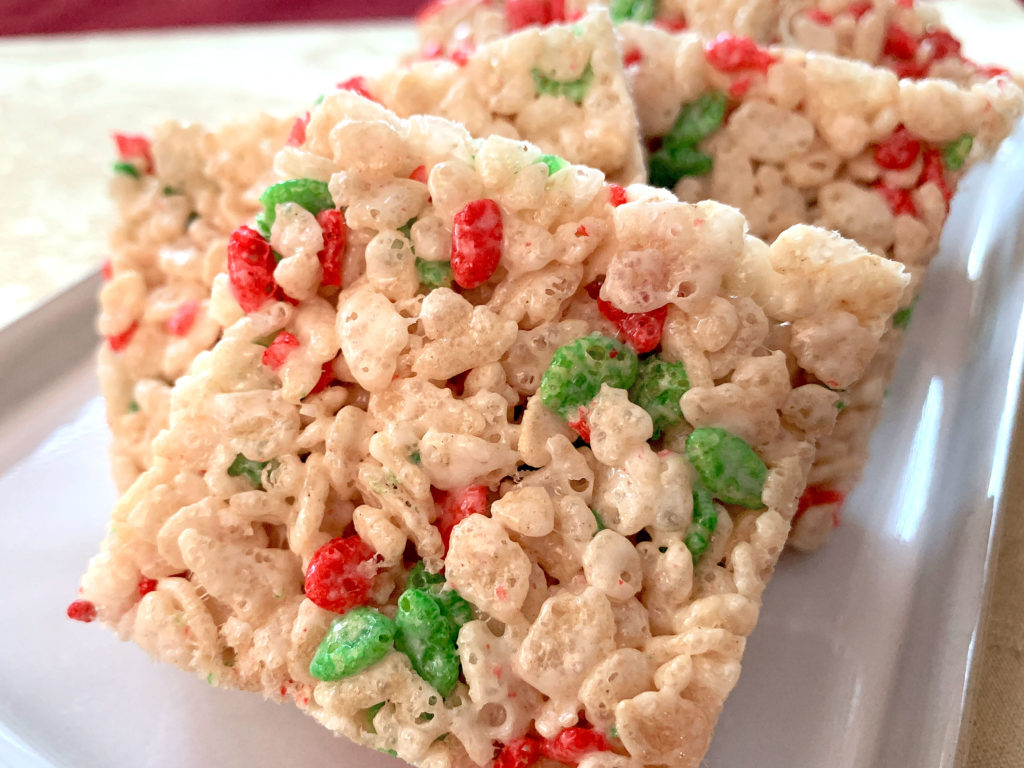 rice krispies cut into squares on a plate