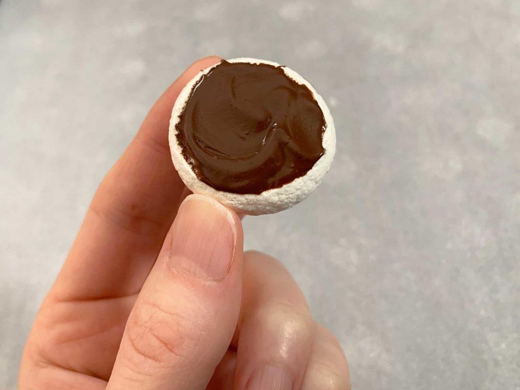 putting chocolate on the bottom of a mushroom cap
