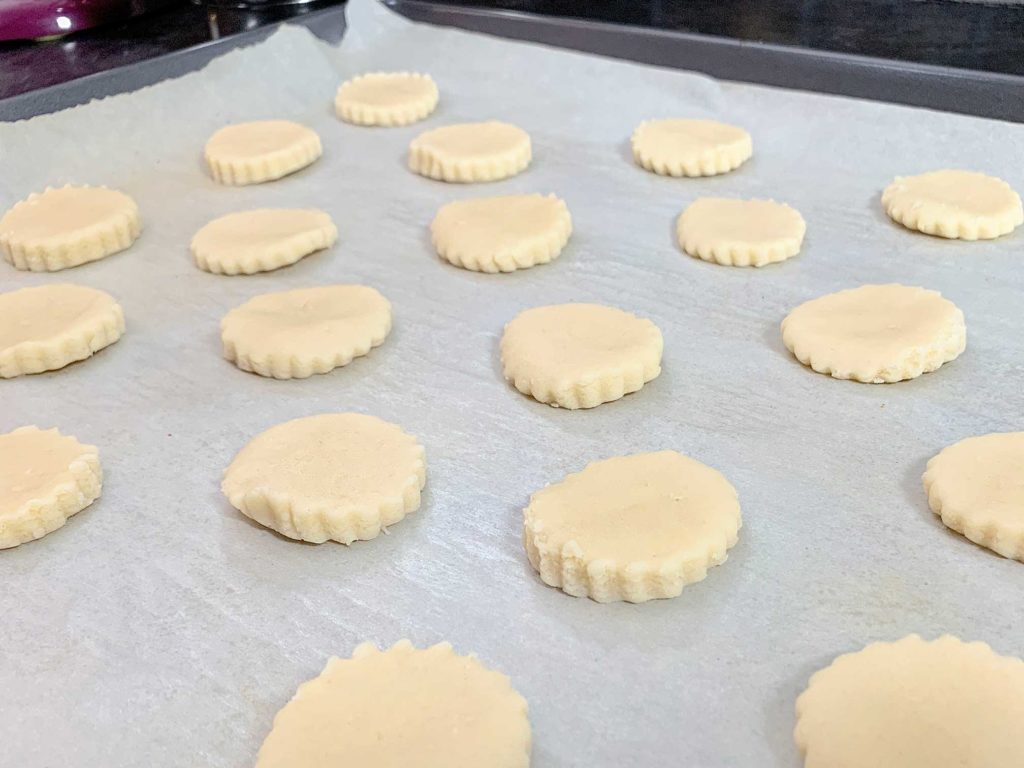cut dough pieces on a cookie tray ready for making