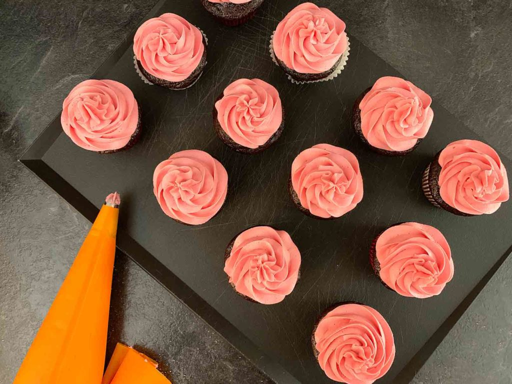 Cupcakes decorated with raspberry buttercream frosting