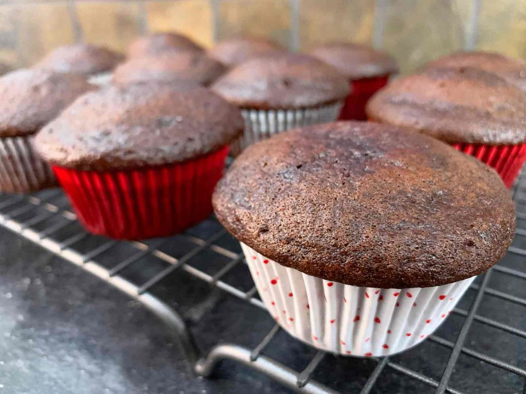 Fresh baked chocolate cupcakes on a cooling rack
