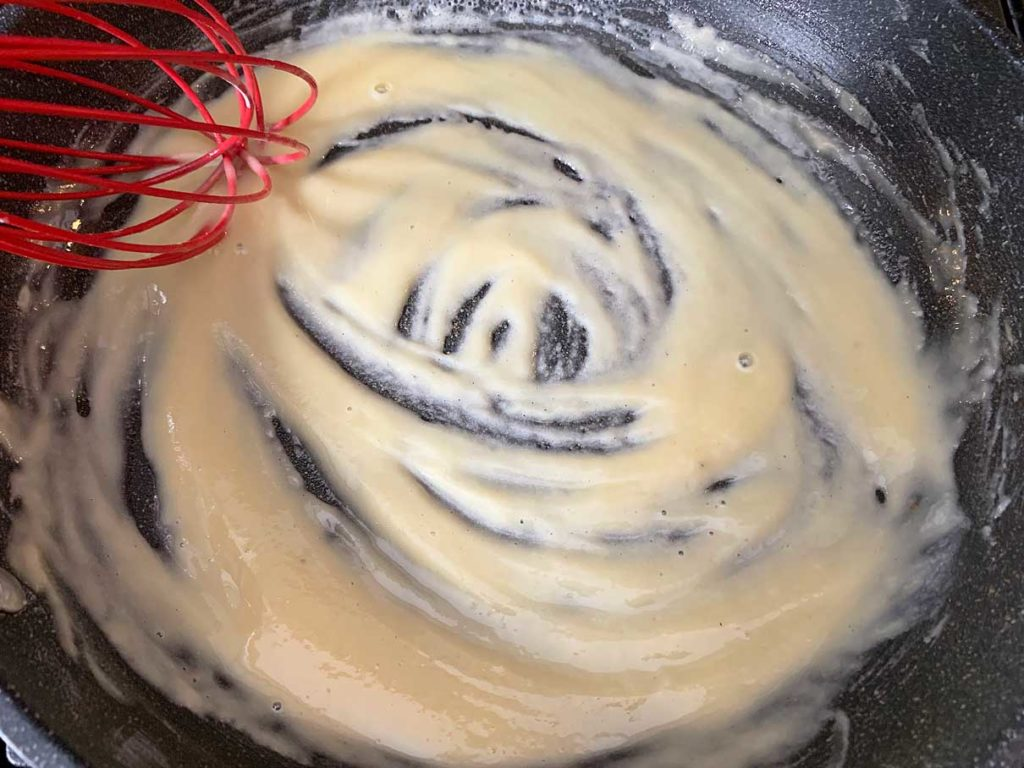 mixing the flour into the butter to make a thick paste