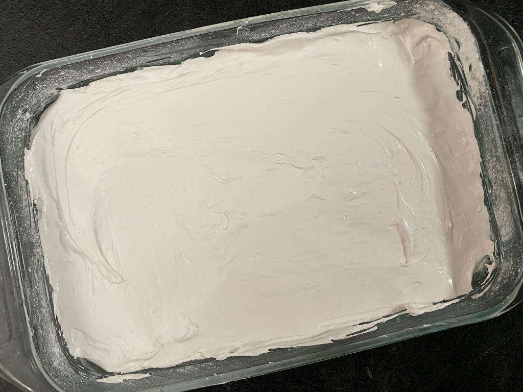 Marshmallow mixture spread evenly into a 9x13 pan
