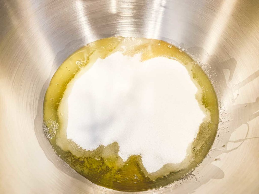 Sugar and eggs in the bowl of a stand mixer