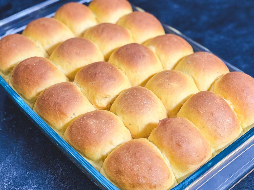baking dish full of rolls fresh from the oven