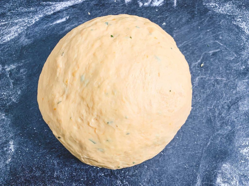 ball of kneaded dough on floured surface