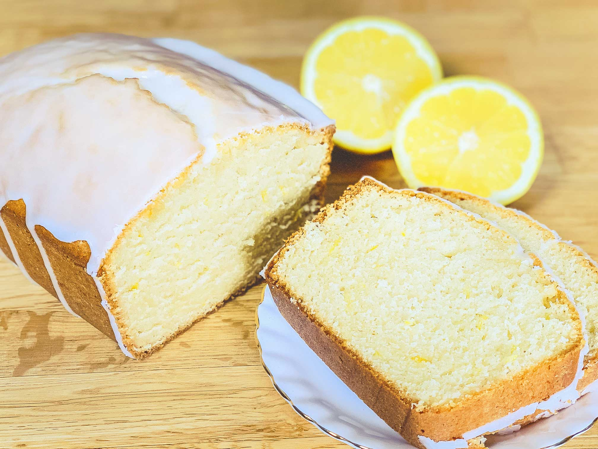lemon loaf sliced on a plate