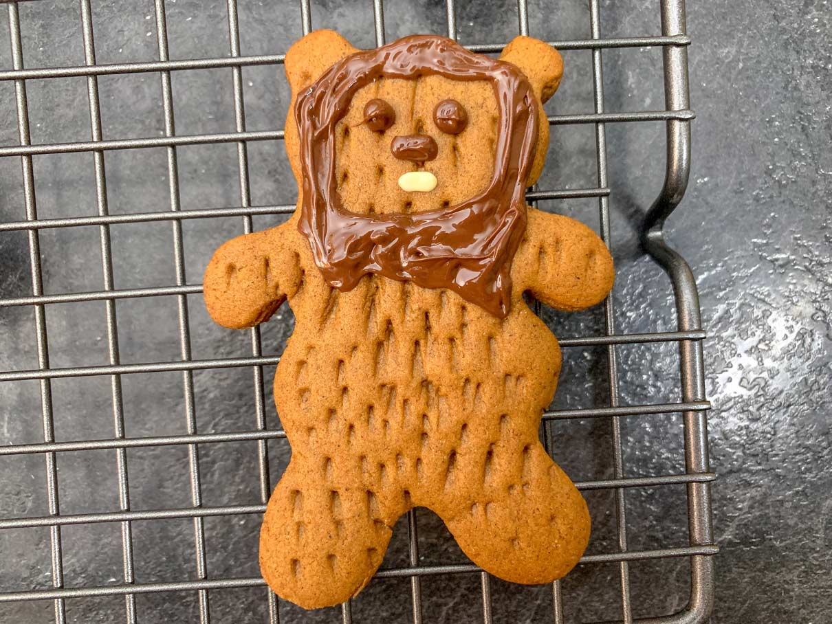 close up of ewok cookie with piped chocolate details