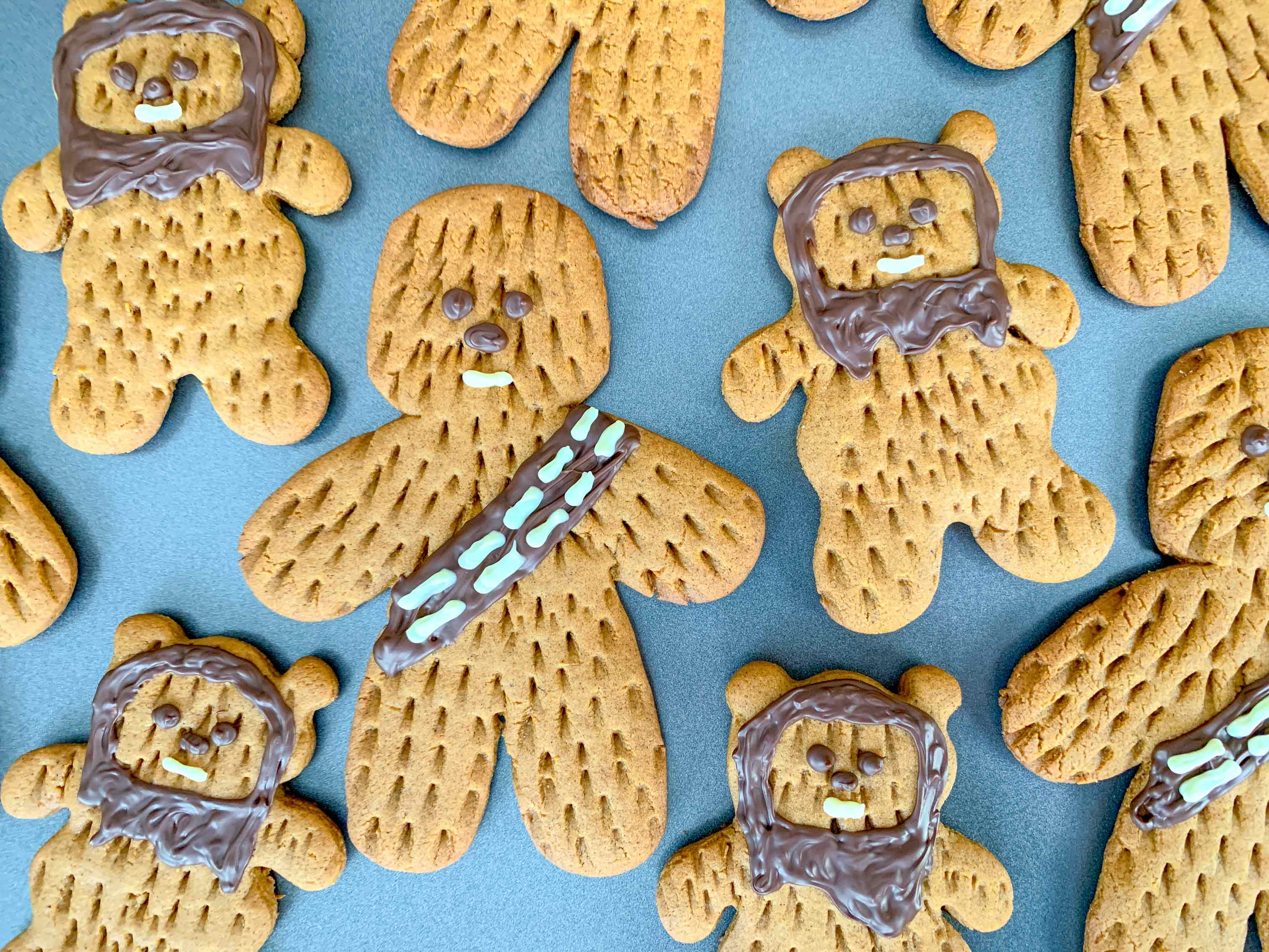 close up of decorated Chewbacca and Ewok cookie on baking tray