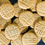 Peanut butter cookies stacked on a wire cooling rack