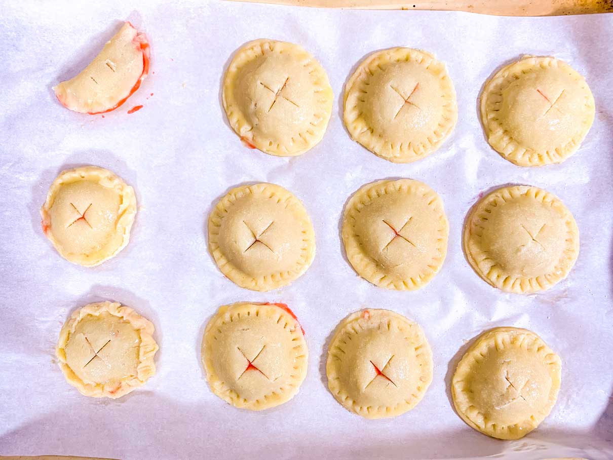 assembled pies with an 'x' cut into the top