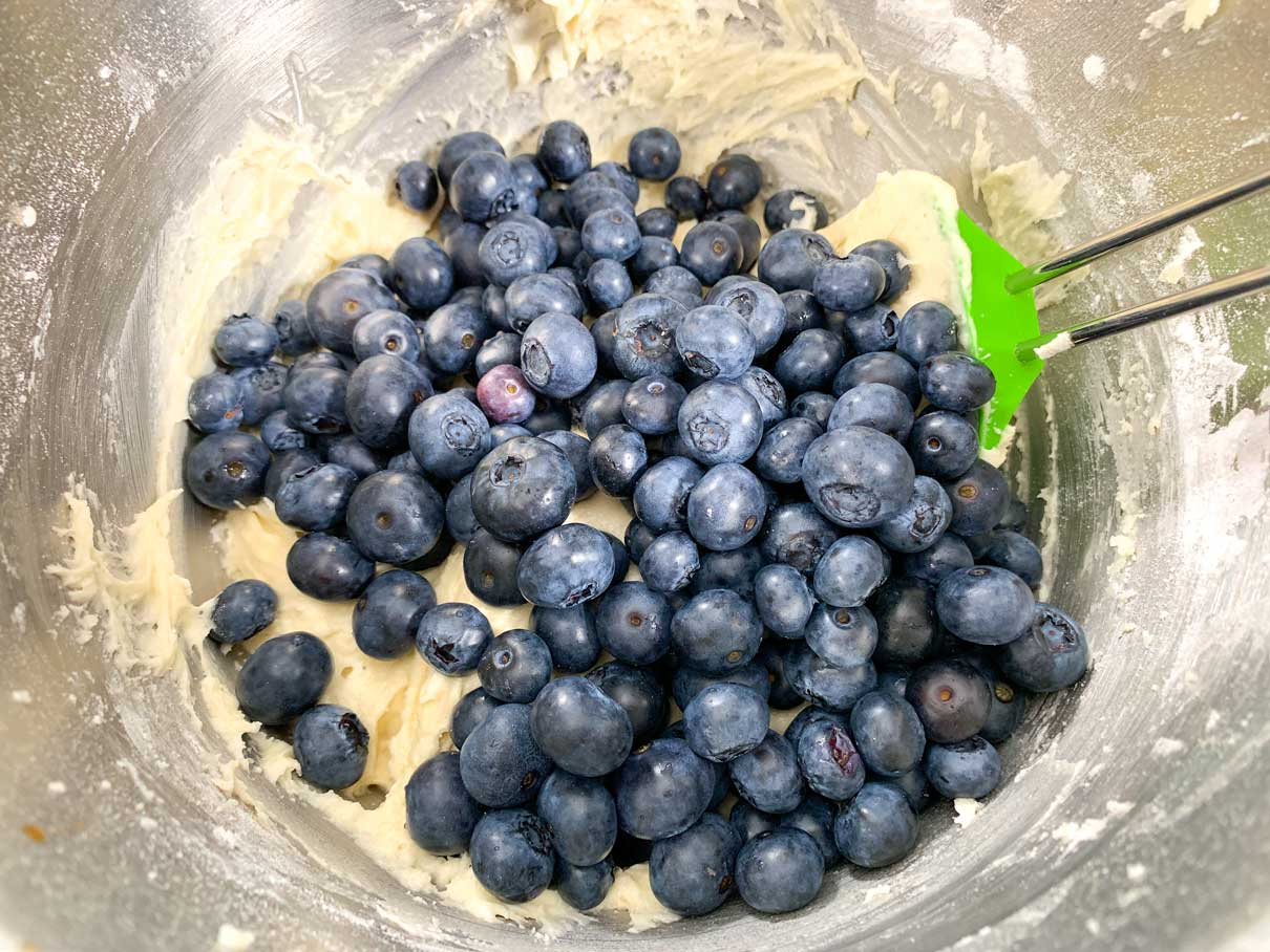 blueberries piled on top of batter