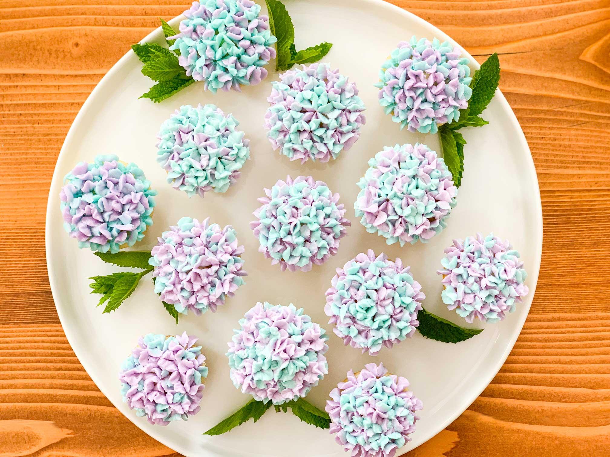 Mini hydrangea cupcakes on a round plate