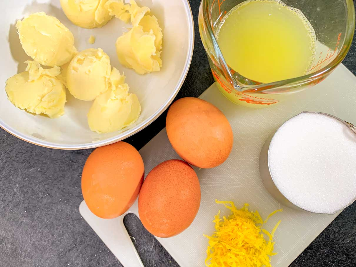lemon curd ingredients on counter (butter, lemon juice, zest, eggs and sugar)