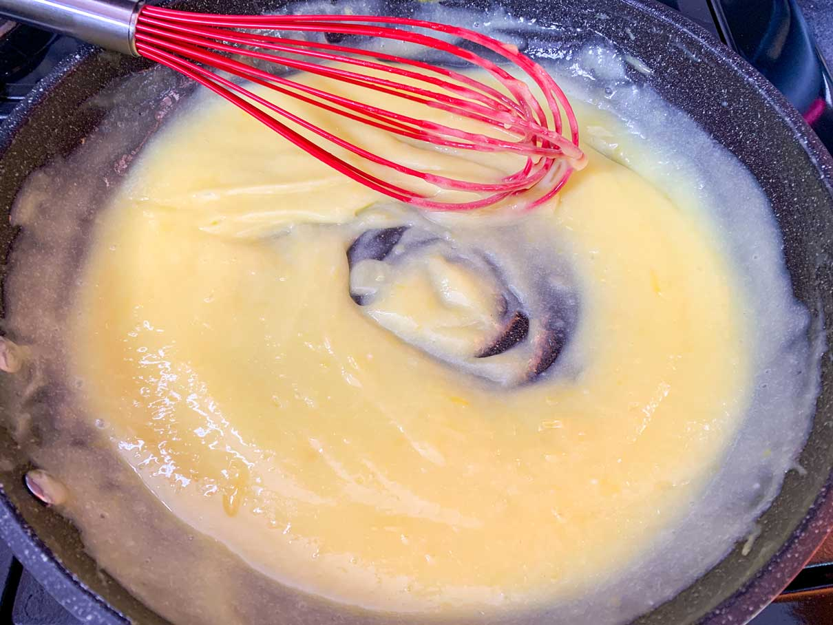 thickened lemon curd in a frying pan