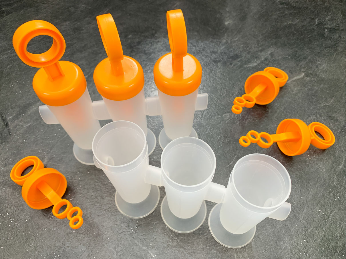 Plastic popsicle moulds ready for filling