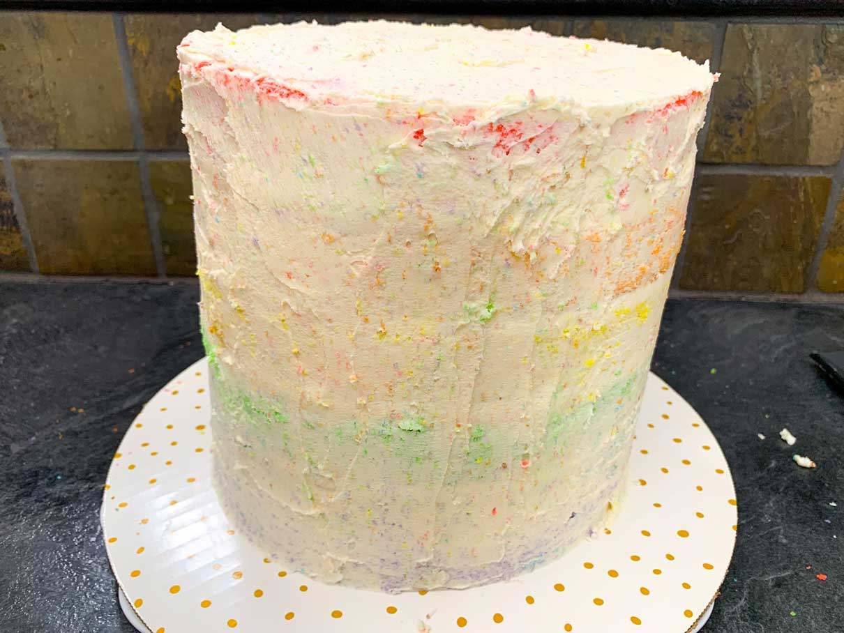 cake with a crumb coat layer of buttercream on the outside