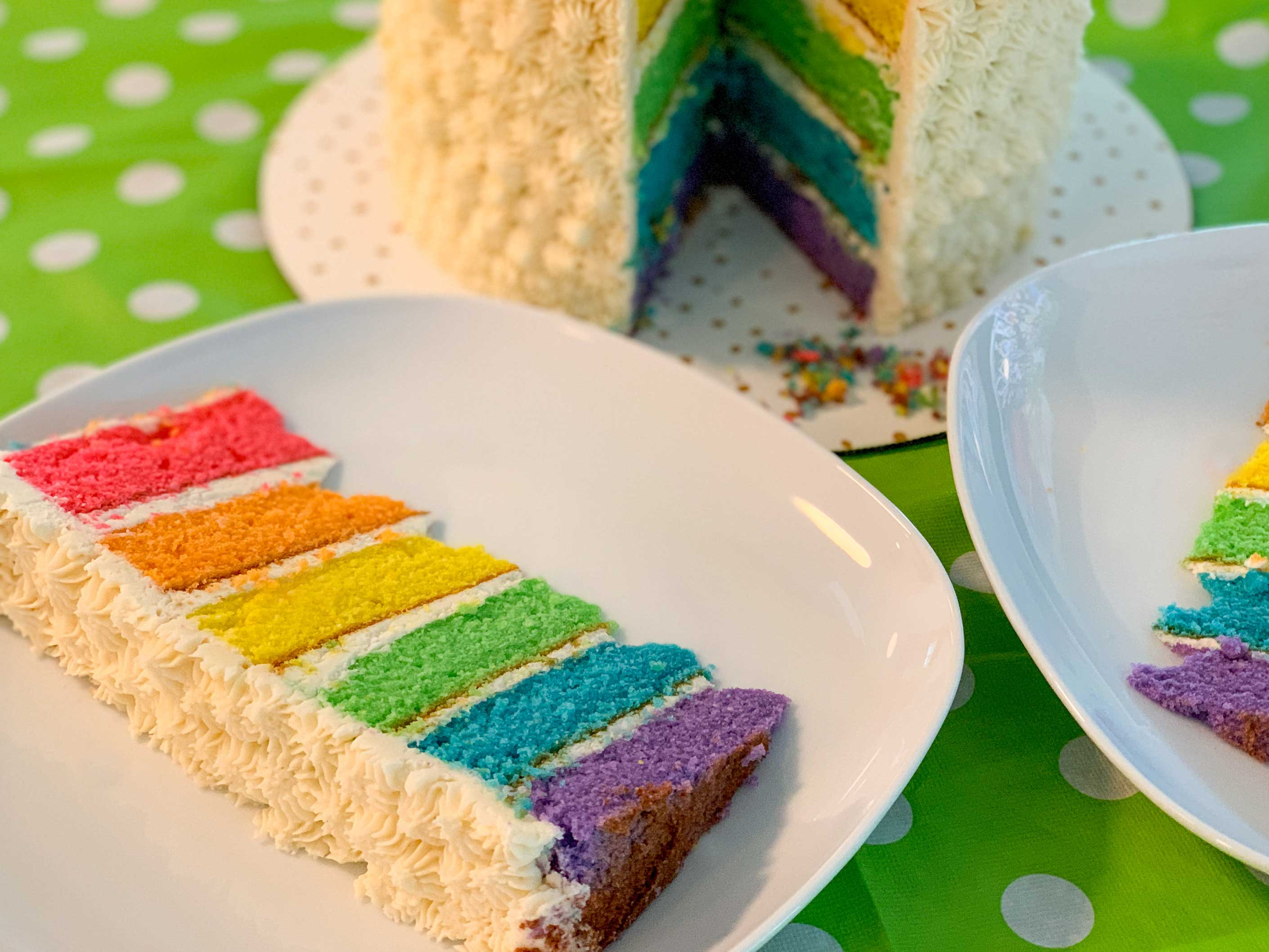 close up shot of a slice of the rainbow cake