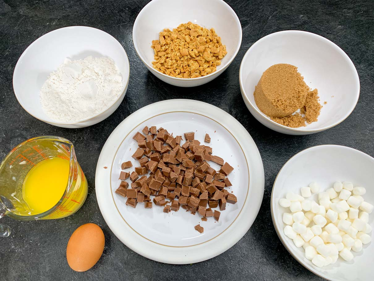 Smore's cookie ingredients measured out and in bowls