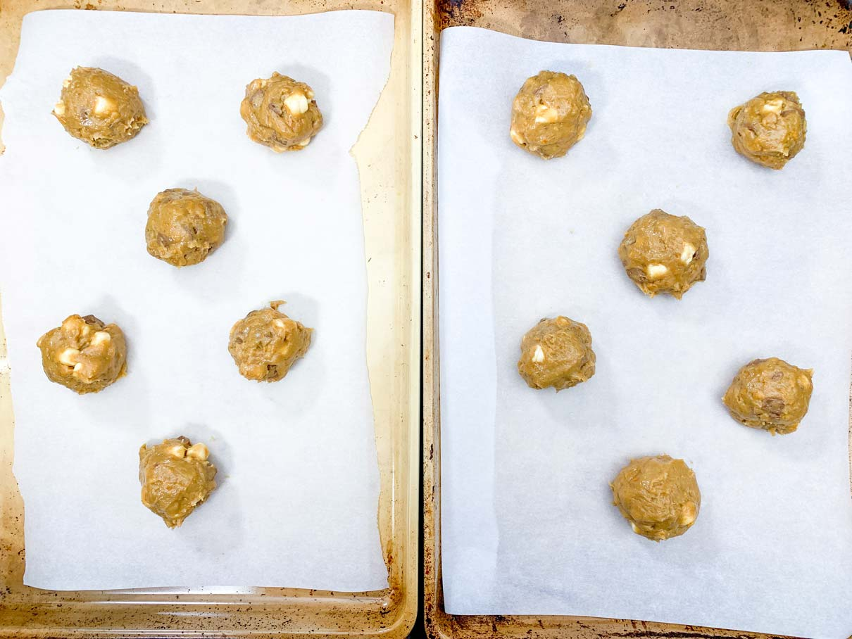 cookie dough balls on trays ready for baking