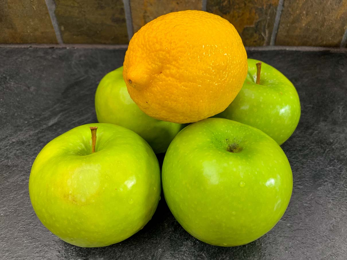 apples and a lemon on the kitchen counter