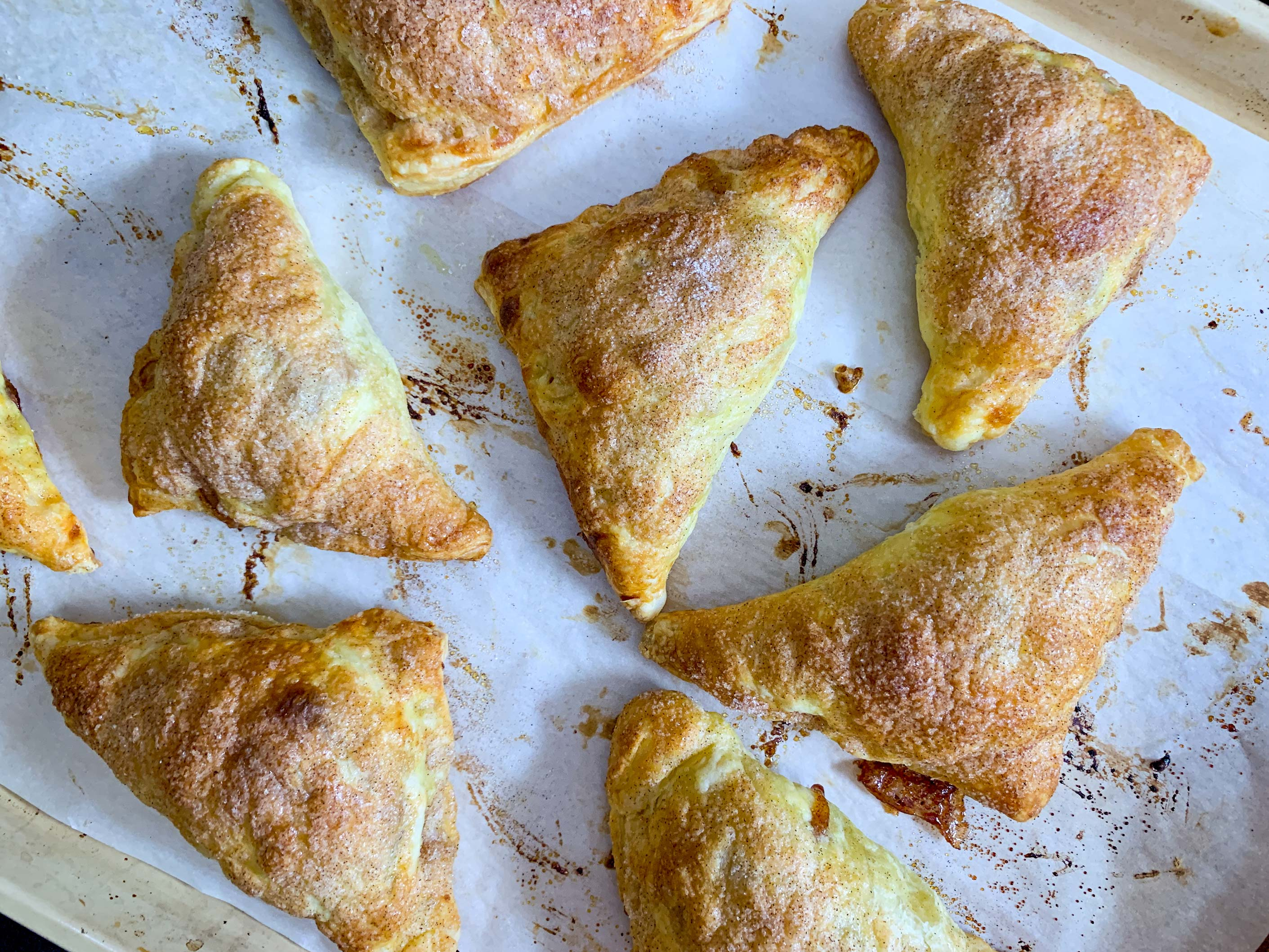 Fresh baked apple turnovers, cooling on a baking tray