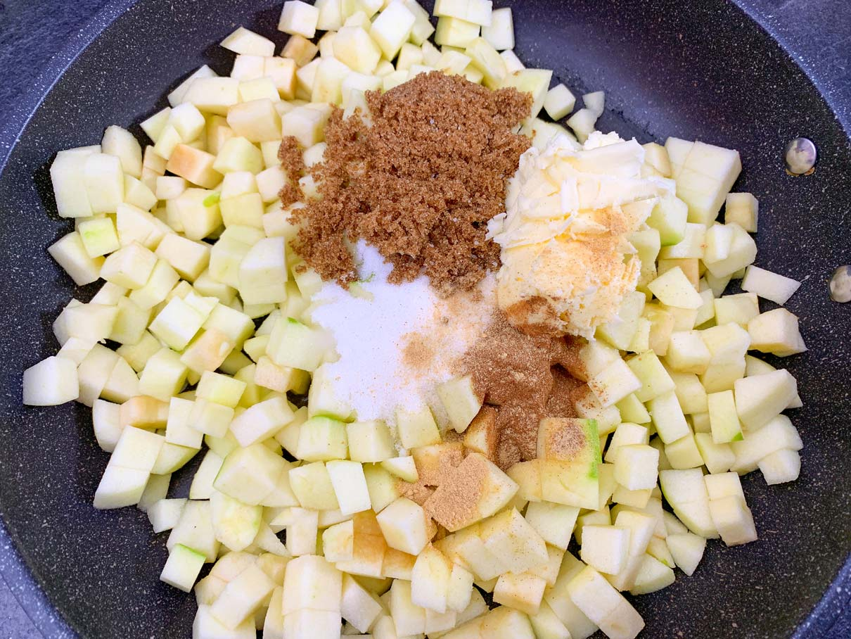 apple filling ingredients in a frying pan, ready to be cooked
