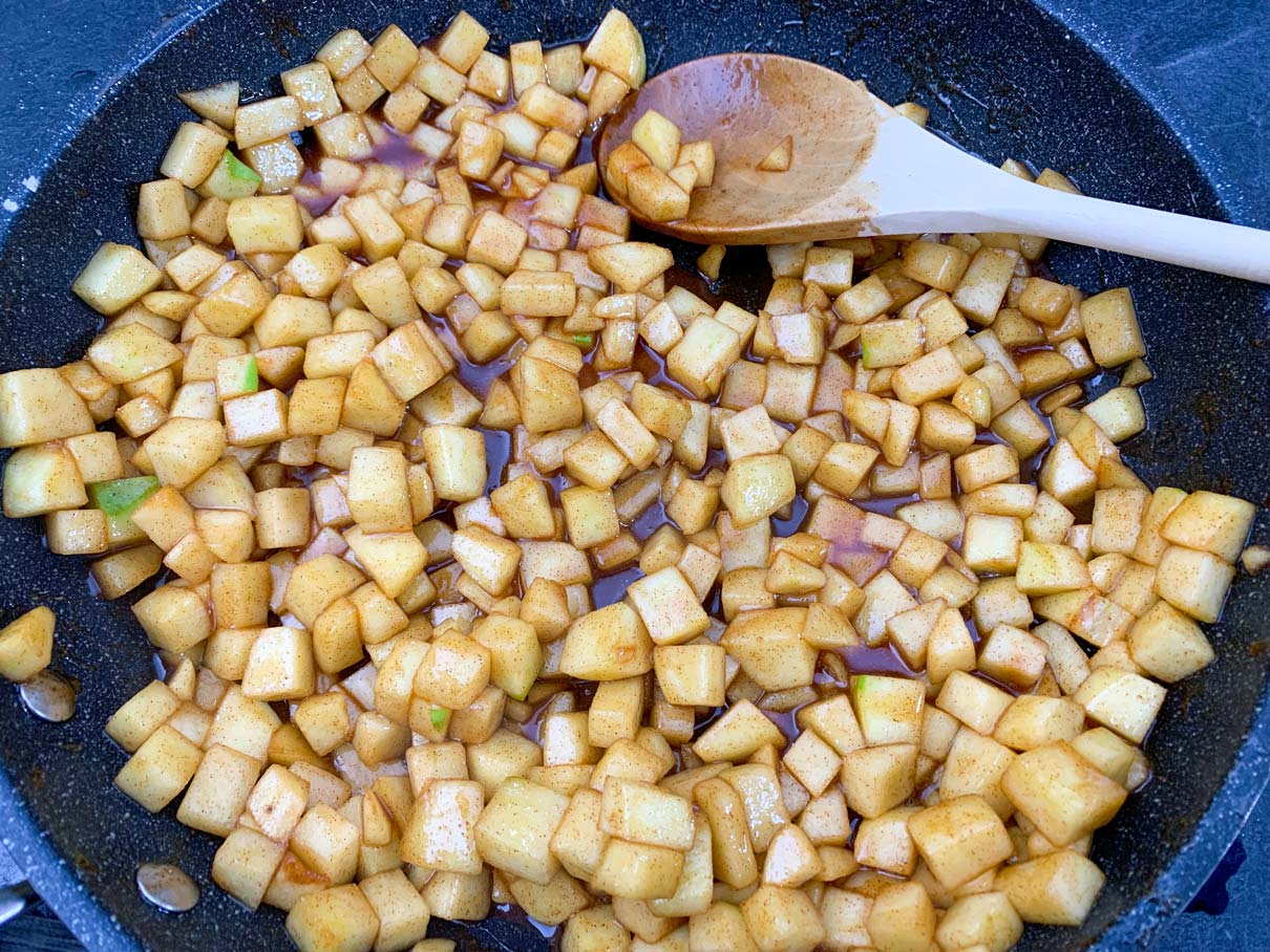 cooked apples with sugar and spices, cooling in the frying pan