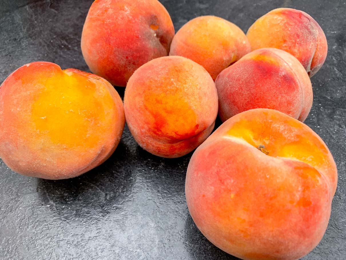 Fresh peaches, sitting on the counter