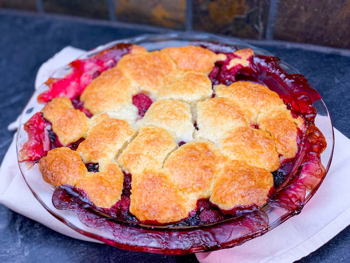 mixed berry cobbler, fresh from the oven, cooling on the counter