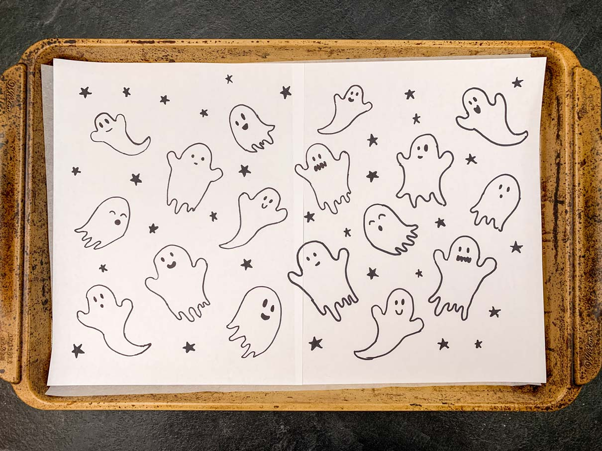 Paper on jelly roll pan with ghosts and stars drawn all over