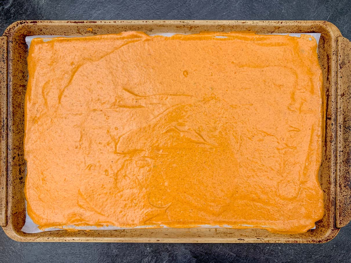 the orange batter spread on top of the piped design