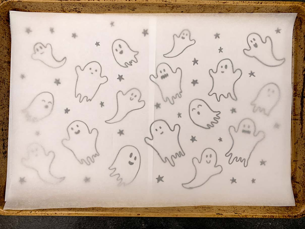 Parchment paper overtop of the drawing of the ghosts