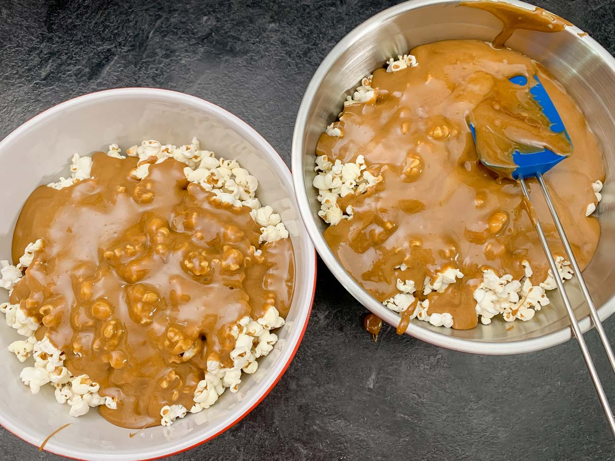pouring the caramel over the popcorn