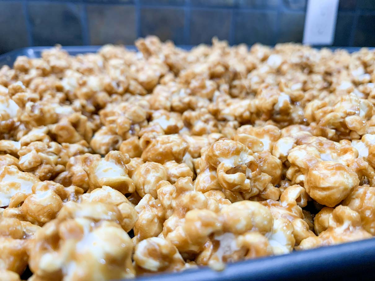 close up of the popcorn spread out into a baking pan