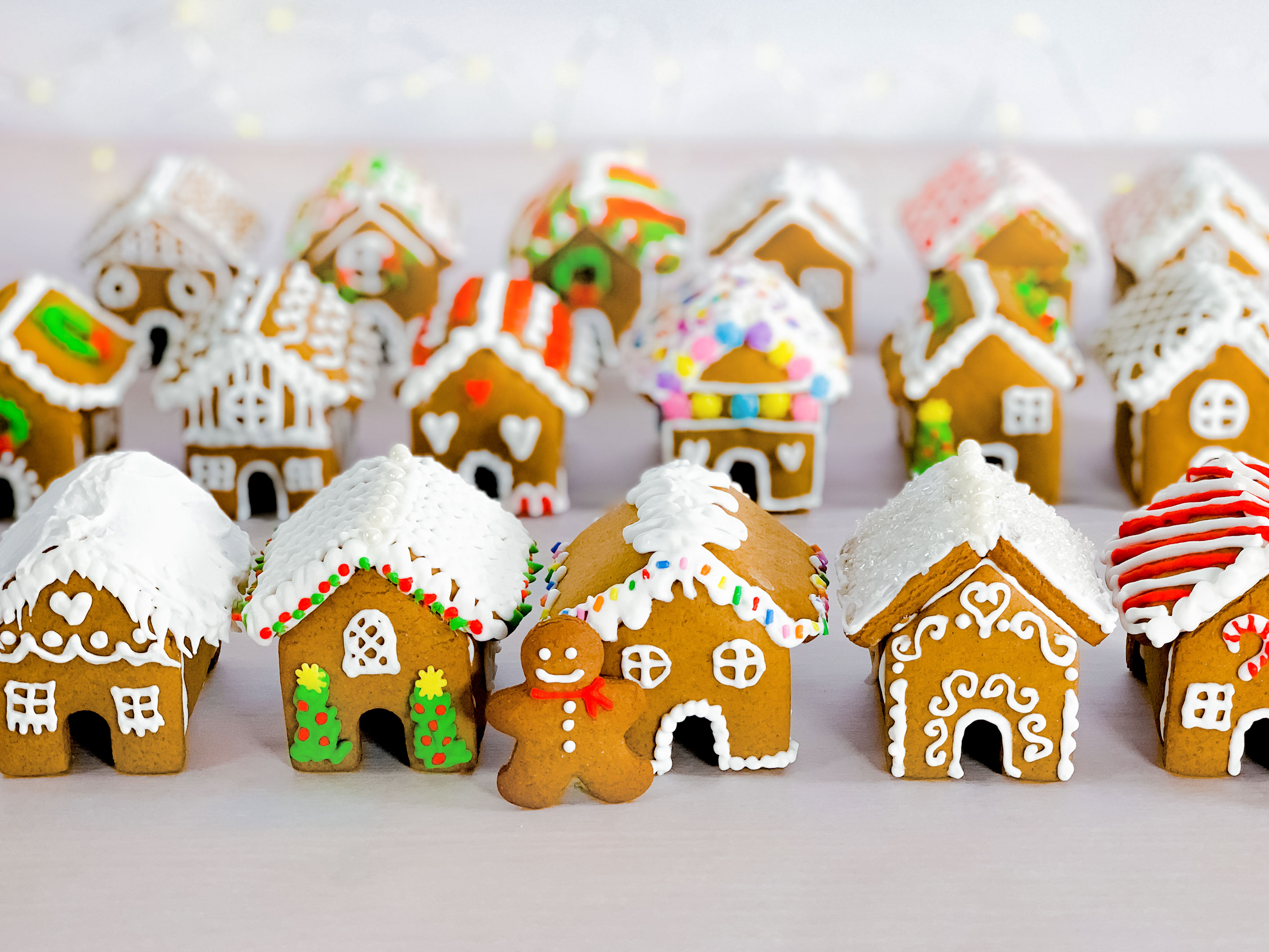 a group of mini gingerbread houses after they have been decorated