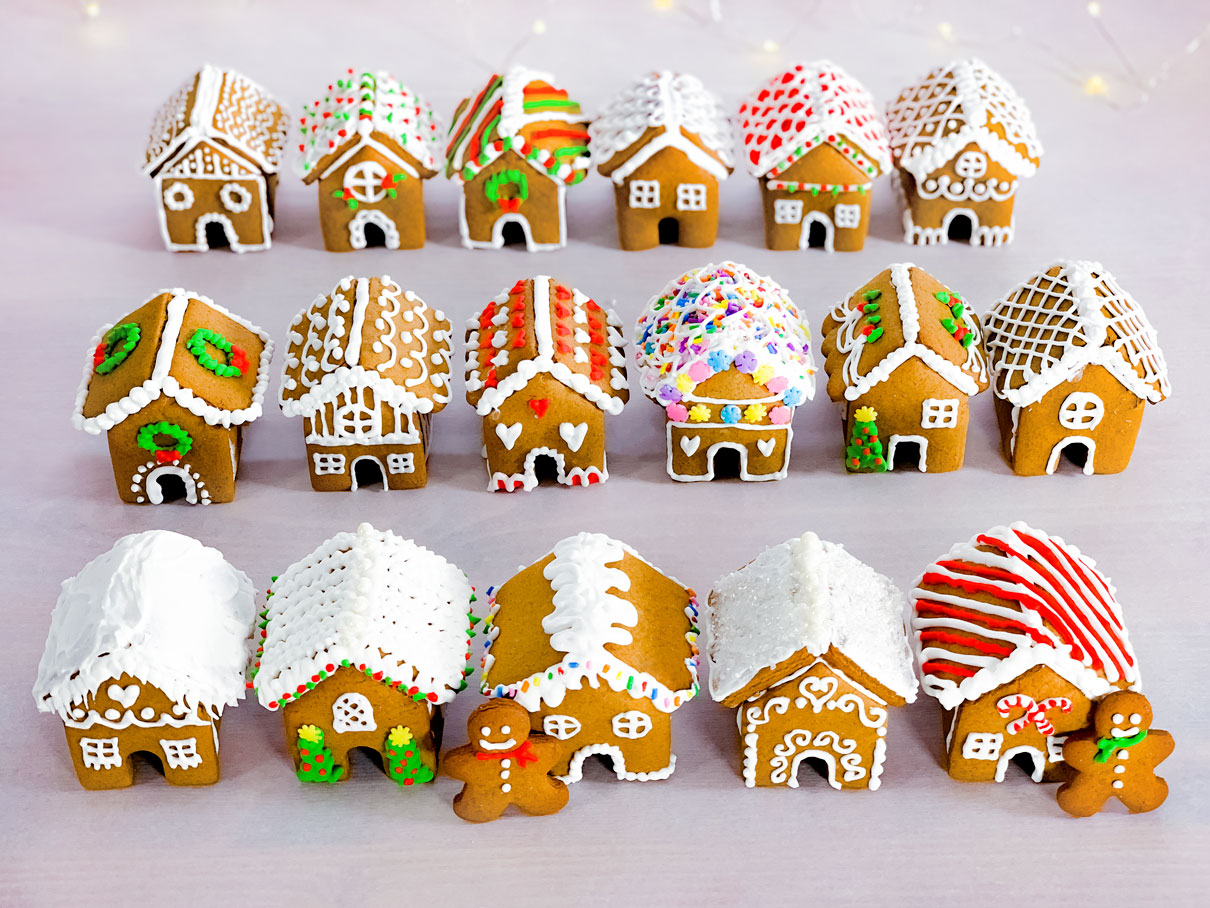 all the decorated gingerbread houses, arranged into three rows