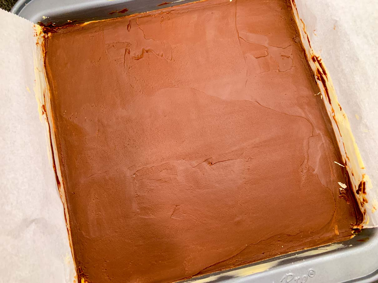 The pan of Nanaimo bars, after the chocolate has been smoothed onto the surface