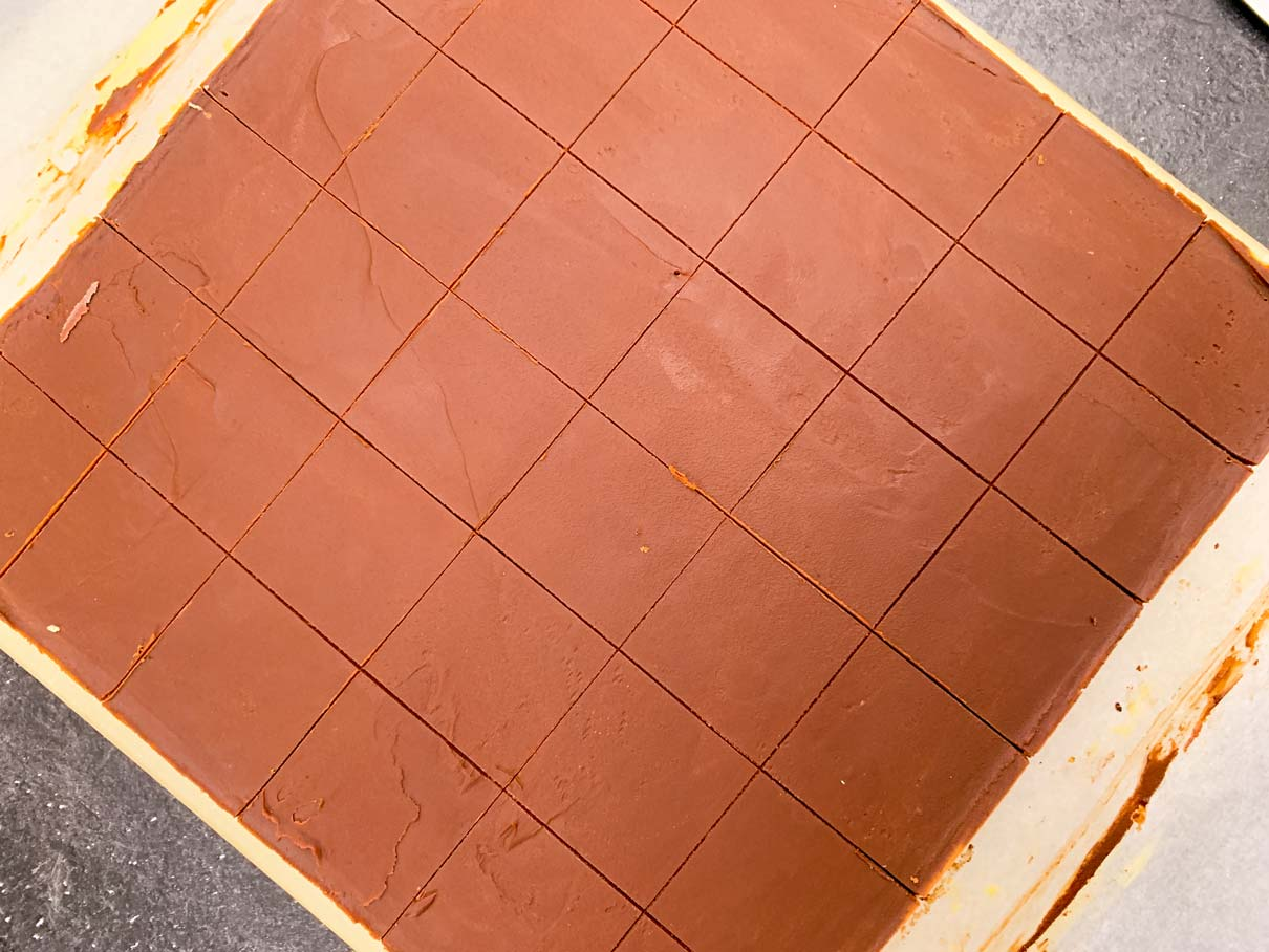 The top of the Nanaimo bars, after the chocolate has been scored with a knife, ready to cut into small squares